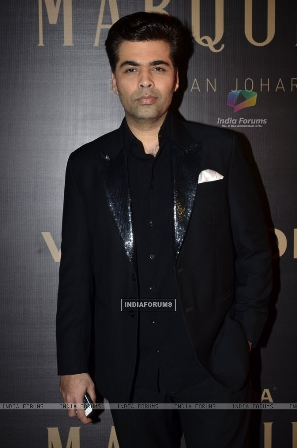 Karan Johar poses for the media at the Launch of Vero Moda MARQUEE Collection