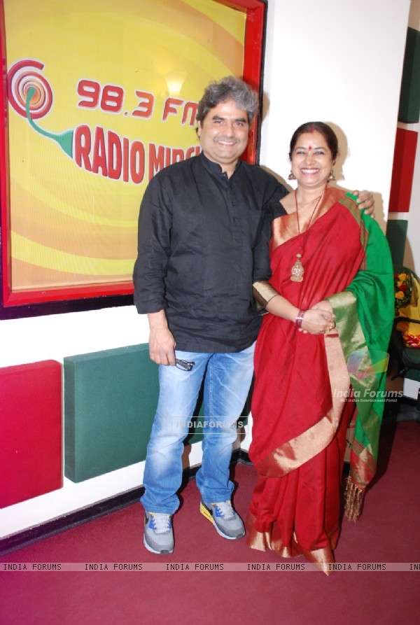 Vishal Bharadwaj and Rekha Bharadwaj pose for the media at Radio Mirchi Studio