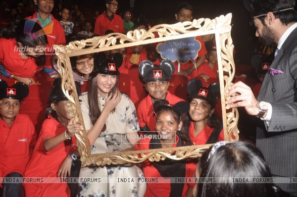 Sonam Kapoor poses with young fans at the Special Screening of Khoobsurat
