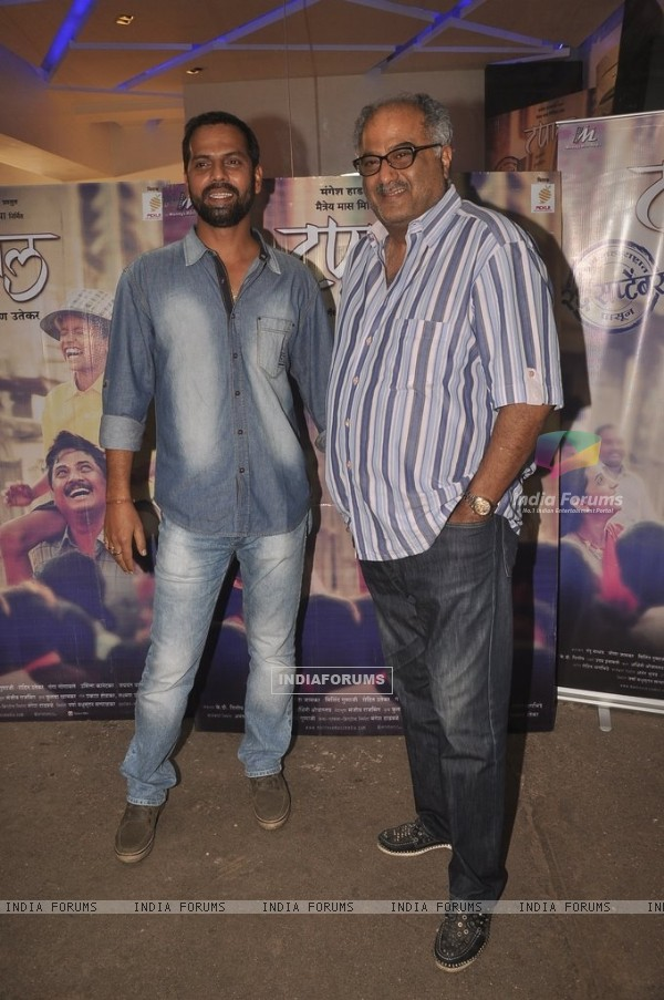 Boney Kapoor poses with a friend at the Screening of Marathi Movie Taapal