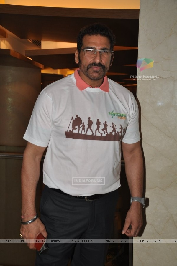Mukesh Rishi poses for the media at Footsteps 4 Good Ngo Event