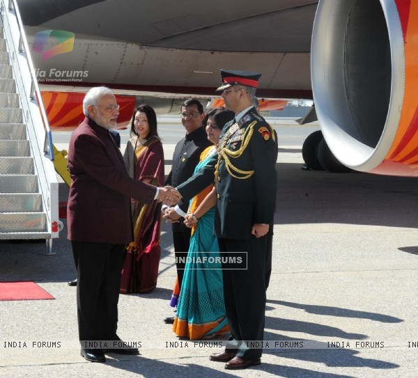 Narendra Modi greets an Officer at the United States of America Airport