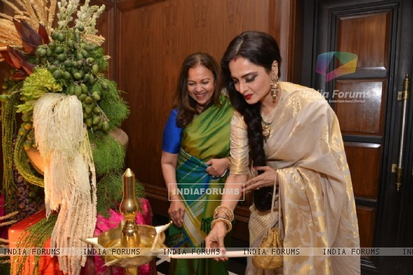 Rekha lighting the lamp at the Sahachari Foundations Show for Tarun Tahiliani
