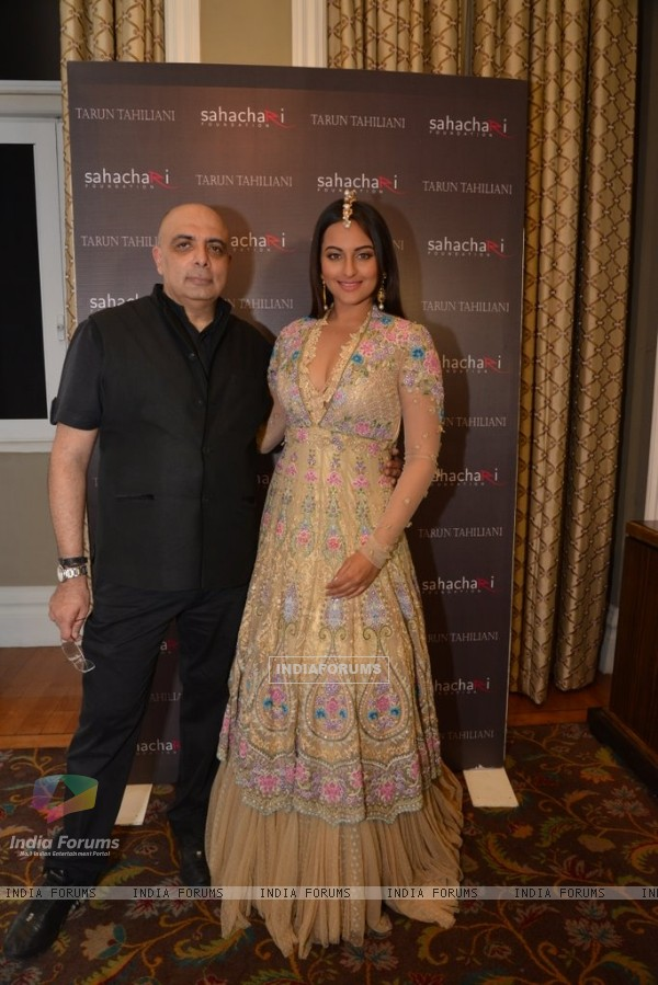 Sonakshi Sinha poses with Tarun Tahiliani at the Sahachari Foundations Show