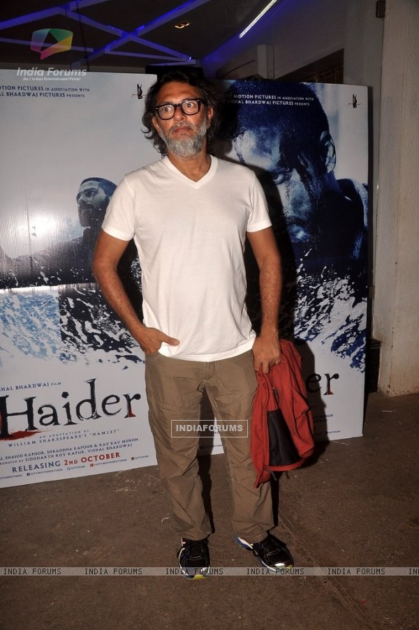 Rakesh Omprakash Mehra poses for the media at the Special Screening of Haider