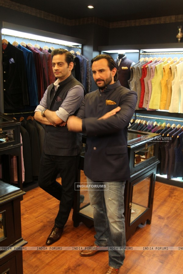 Saif Ali Khan poses with Raghavendra Rathore at his New Men's Jewellery Store
