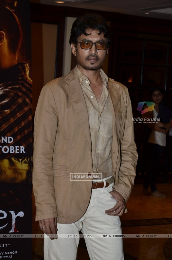 Irrfan Khan poses for the media at the Book Launch of Haider, Omkara and Maqbool