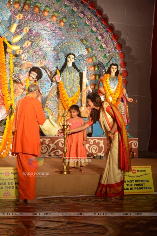 Sushmita Sen lighting the lamp at Durga Pooja