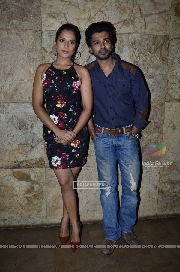 Richa Chadda and Nikhil Dwivedi pose for the media at the Special Screening of Tamanchey