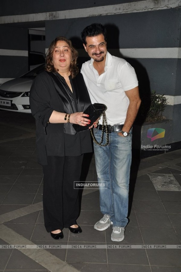 Sanjay Kapoor poses with Reema Jain at his residence