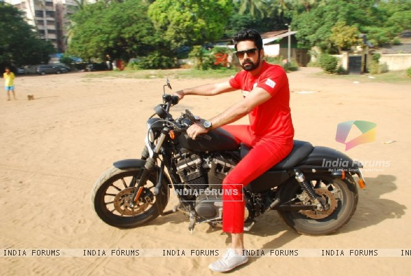 Avinash Sachdev poses on a bike at the Shoot for the New Season of Box Cricket League