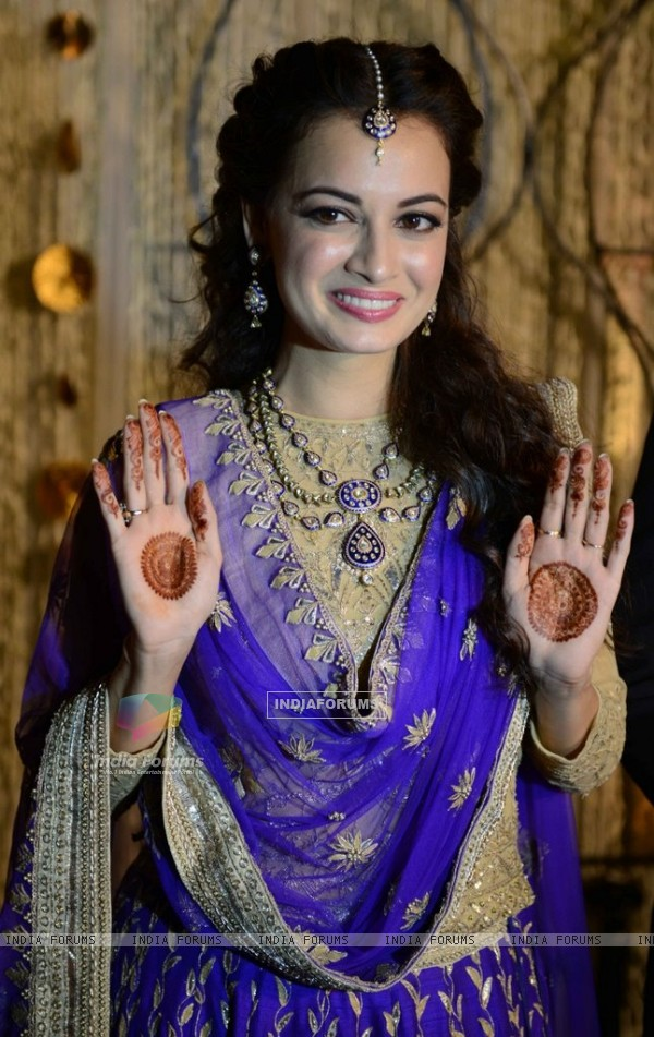 Dia Mirza shows her mehendi at her Sangeet Ceremony