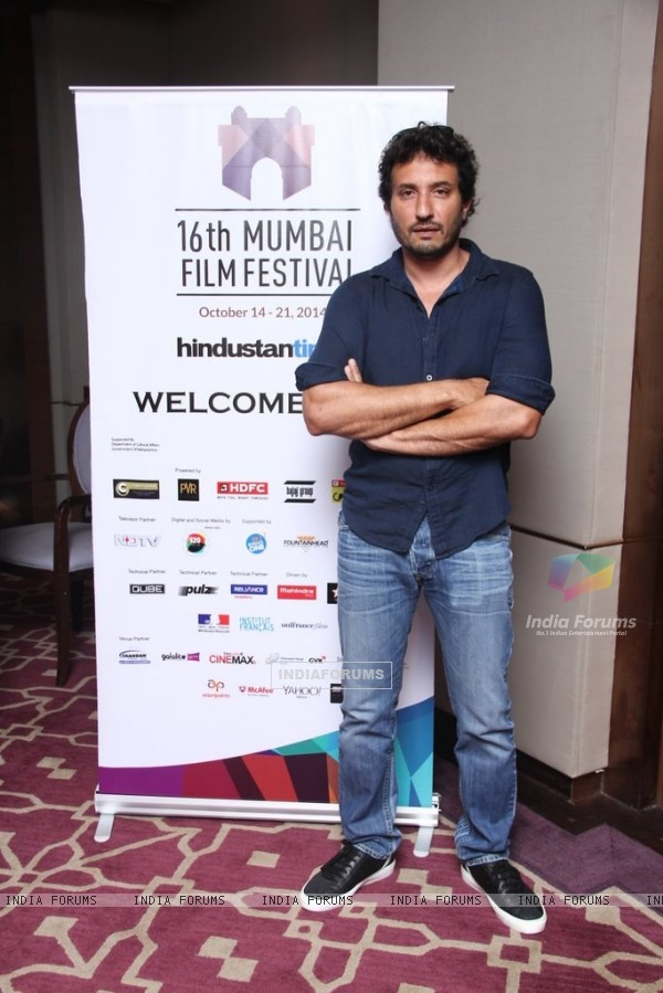 Homi Adajania poses for the media at the 16th MAMI Film Festival