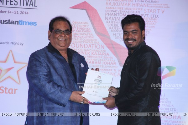 Satish Kaushik presents an award to a winner at the Closing Ceremony of 16th MAMI Film Festival