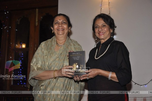 Tanuja poses with Bimal Roy's Book at the Launch