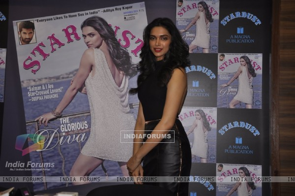 Deepika Padukone poses with the Cover of Stardust Magazine