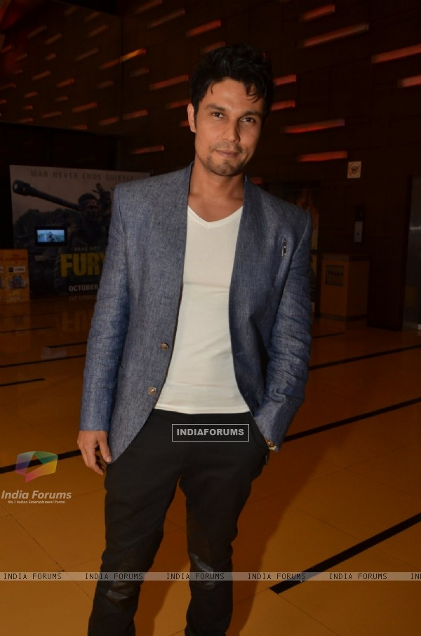 Randeep Hooda poses for the media at the Premier of Rang Rasiya