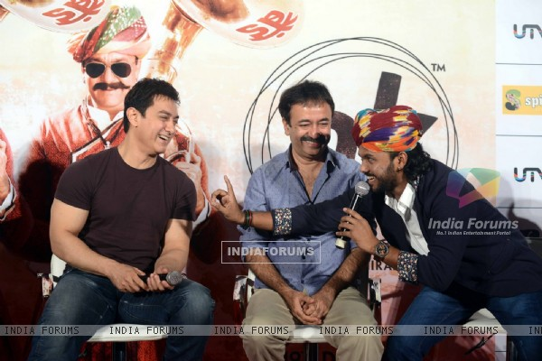Aamir Khan interacts with the singer at the Song Launch of P.K.