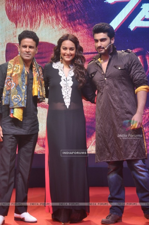Manoj Bajpai, Arjun Kapoor and Sonakshi Sinha pose for the media at the Trailer Launch of Tevar