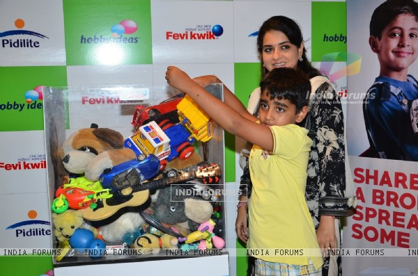 Shaina NC with her son at the Hobby iDEAS Children's Day Celebrations