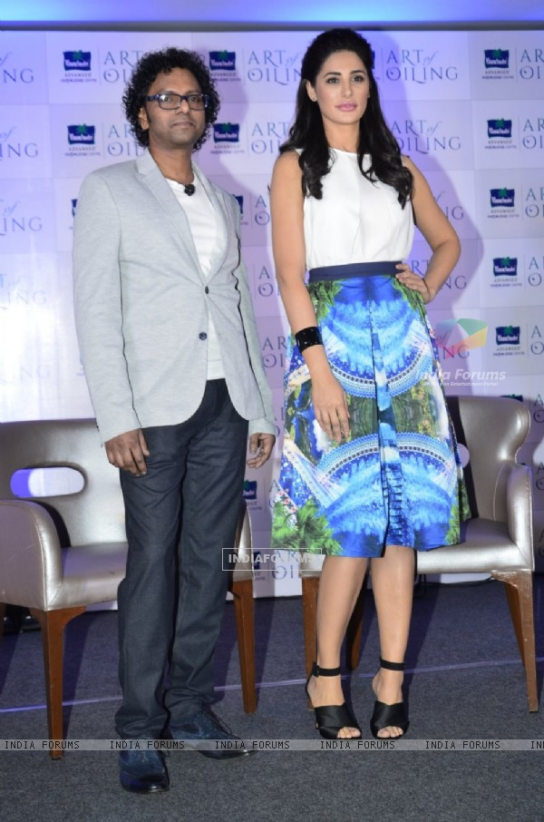 Nargis Fakhri and Massage Guru Moses Chundi at 'Parachute Advanced Art of Oiling' Event