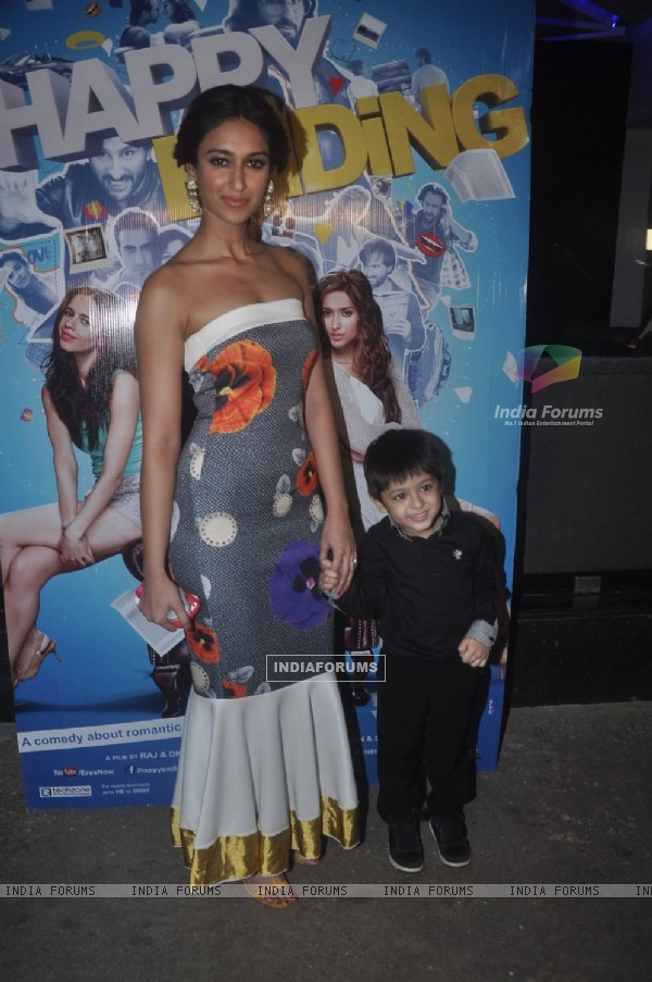Ileana D'Cruz poses with a kid at the Special Screening of Happy Ending