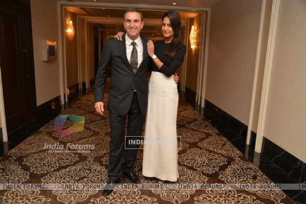 Lisa Haydon poses with a guest at the Launch of Carl F. Bucherer's Pathos Collection in India