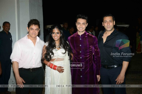 Aamir Khan and Salman Khan pose with the newly wedded couple at Flaknuma Palace