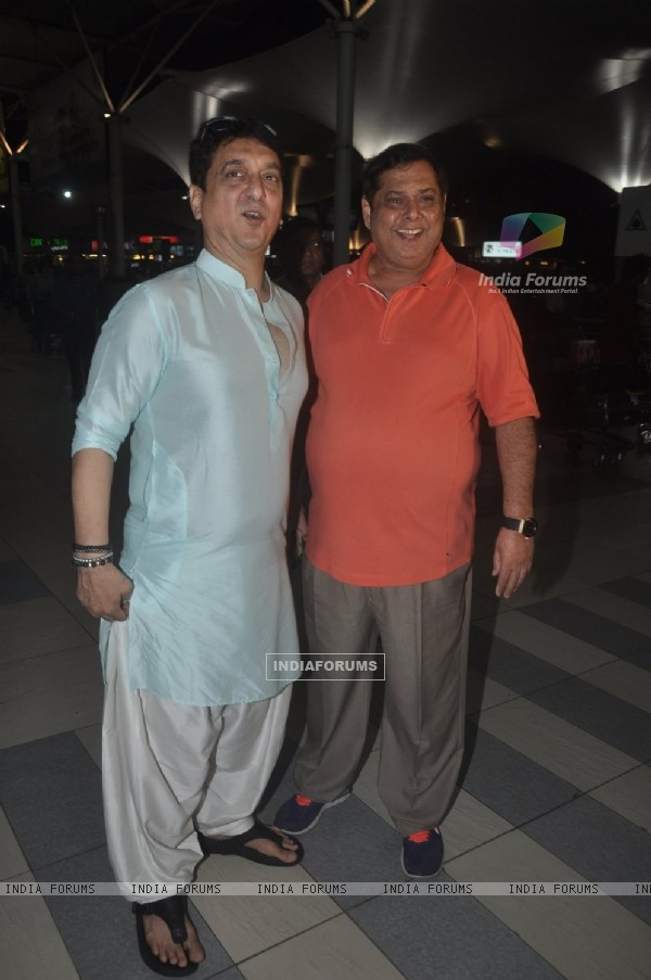 Sajid Nadiadwala and David Dhawan pose at airport while returning from Arpita Khan's Wedding