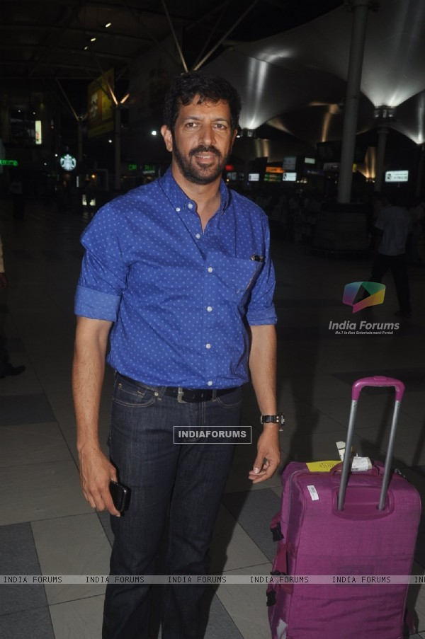 Kabir Khan poses for the media at airport while returning from Arpita Khan's Wedding