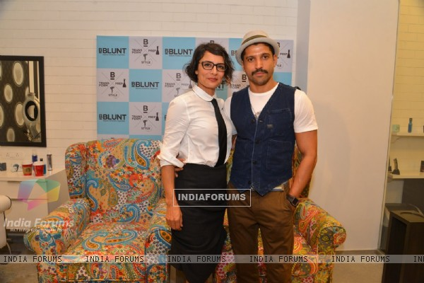 Farhan Akhtar and Adhuna Akhtar pose for the media at the Launch of BBlunt Salon
