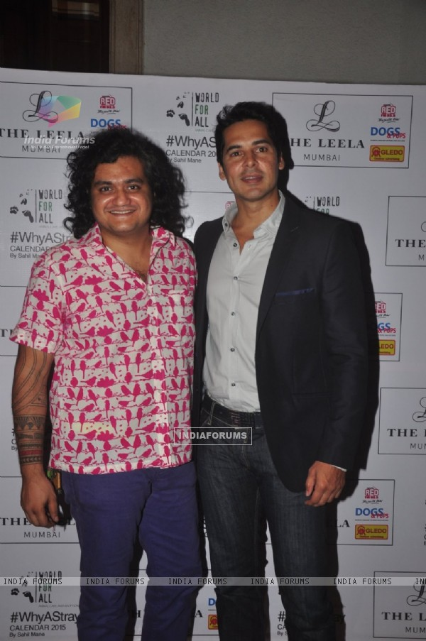 Dino Morea poses with Sahil Mane at 'Why A Stray' Calendar Launch