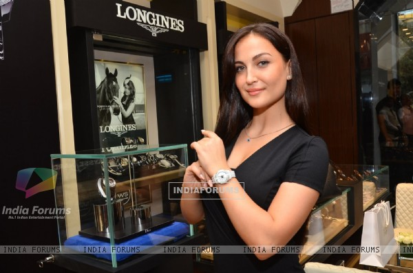 Elli Avram showcases a watch at the Watches of the World Showroom