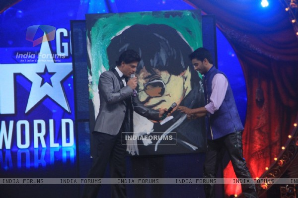 Shah Rukh Khan with a contestant at the Opening of Got Talent - World Stage Live