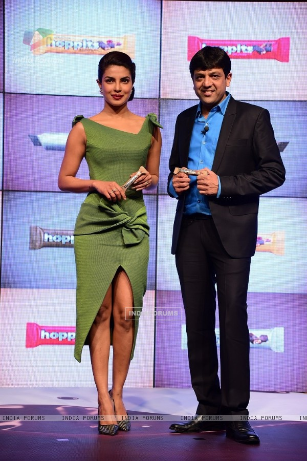 Priyanka Chopra and Jayesh Desai pose for the media at the Launch of Chocolate Bars Hoppits