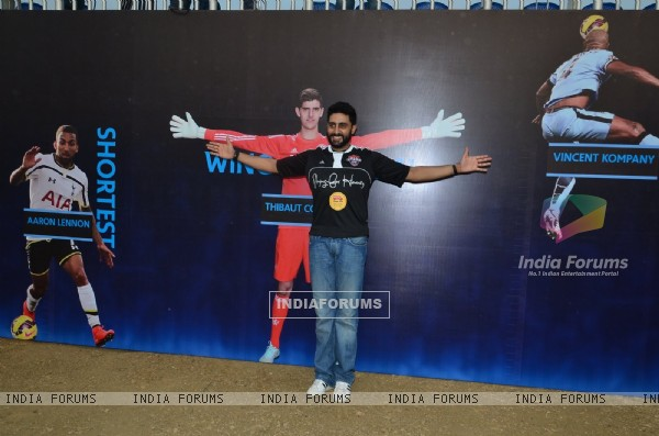 Abhishek Bachchan poses for the media at Barclays Premier League