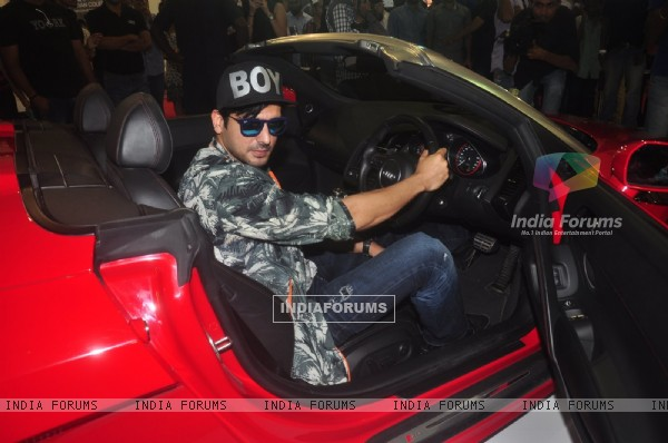 Zayed Khan poses with the Car at Autocar Show