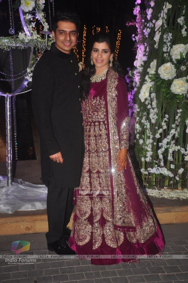 Riddhi Malhotra and Tejas Talwalkar pose for the media at their Sangeet Ceremony