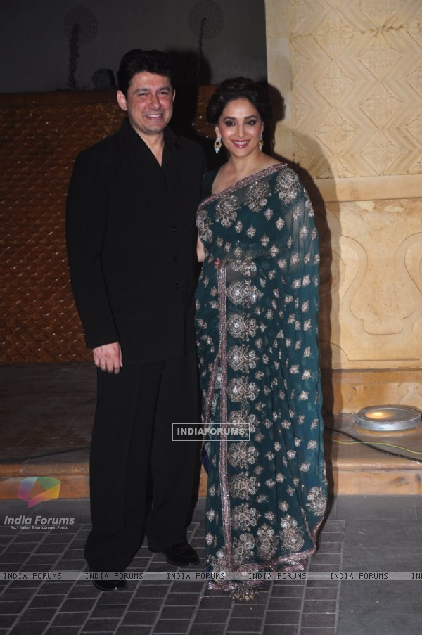 Madhuri Dixit Nene poses with Husband at the Reception of Riddhi Malhotra and Tejas Talwalkar