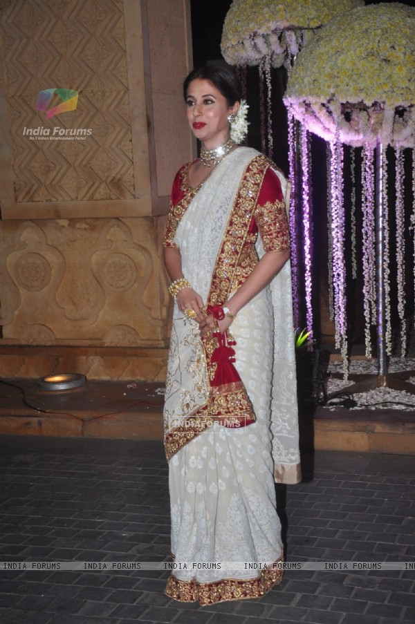 Urmila Matondkar poses for the media at the Wedding Reception of Riddhi Malhotra and Tejas Talwalkar