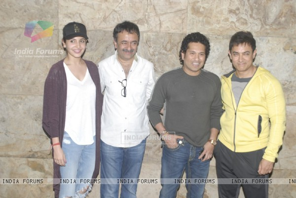 Team of P.K. poses with Sachin Tendulkar at the Special Screening