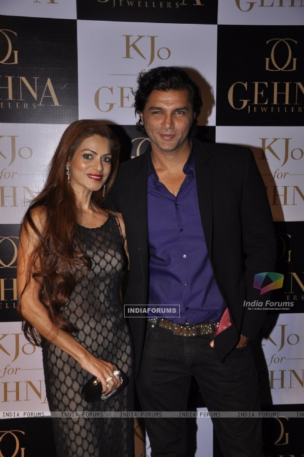 Chetan Hansraj poses with a friend at GEHNA Jewelers Collection Launch 'KJO FOR GEHNA'