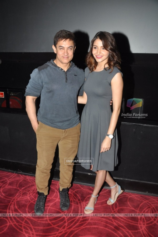 Aamir Khan and Anushka Sharma pose at the Special Screening of P.K. for the Cast and Crew