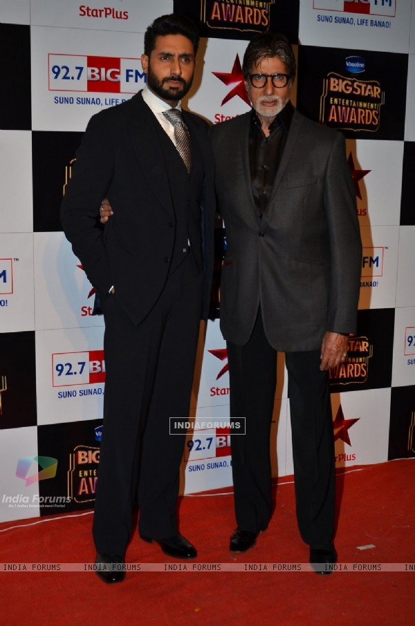Abhishek Bachchan and Amitabh Bachchan pose for the media at Big Star Entertainment Awards 2014