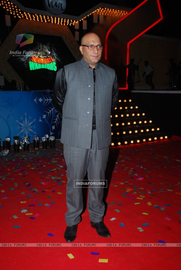 Amit Behl poses for the media at the Annual Day of Vibgyor High School
