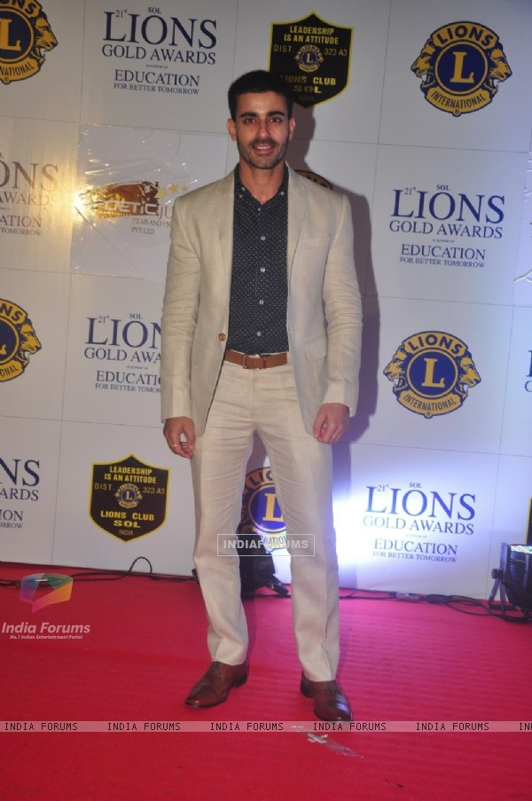 Gautam Rode poses for the media at Lion Gold Awards