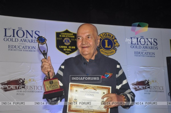 Prem Chopra poses with his award at Lion Gold Awards