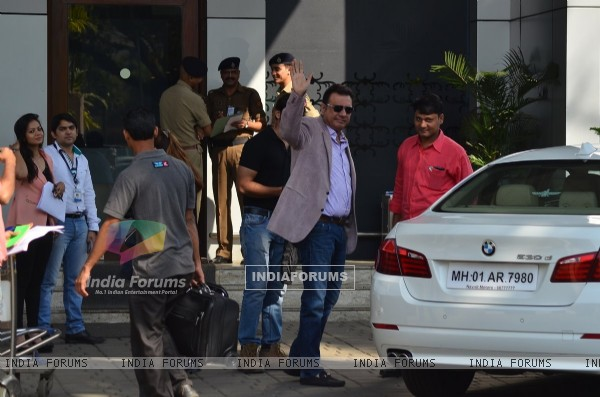 Boman Irani waves out to the cameras at the Airport