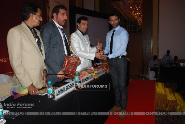 Nandish Sandhu receives an award at Golden Achiever Awards