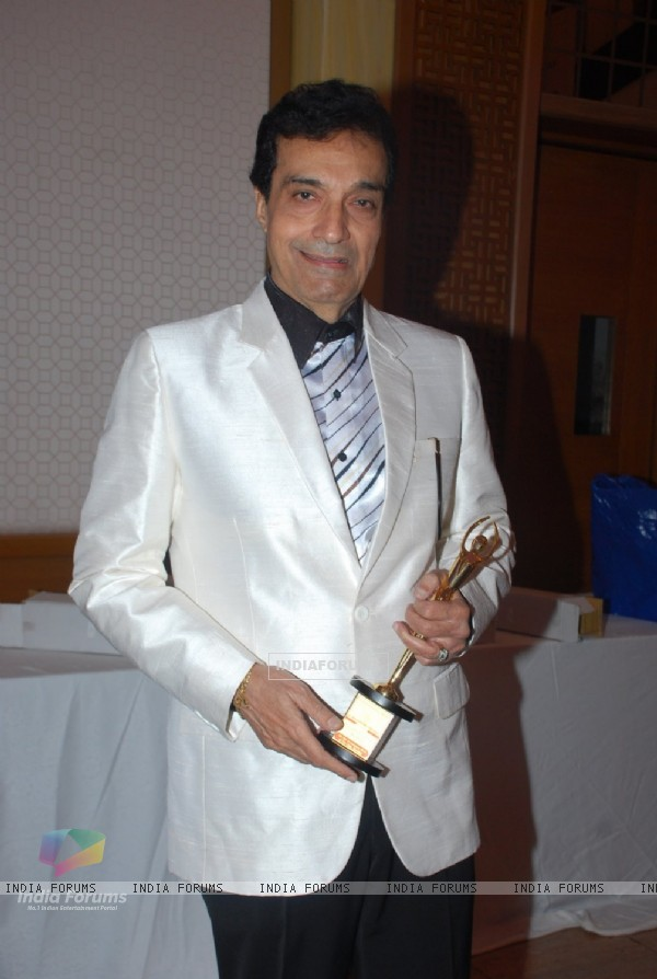 Dhiraj Kumar poses with his award at the Golden Achiever Awards